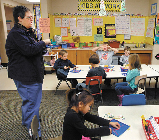Lapel Elementary School kindergarten teacher Catherine Parker gives her students instructions on the project they are working on in this photo taken November 27th.