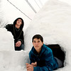 Brandon Gritzmacher, 19, and Christopher Hodson, 15, pose with their eight-foot igloo that they built in a vacant lot on the corner of Walnut and 19th Street in Anderson.  It took the pair seven hours over two days to erect the snow structure.
