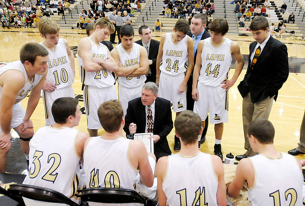 Lapel coach Jimmie Howell talks to his team before the start of the fourth quarter as the Bulldogs hosted Park Tudor on Thursday.