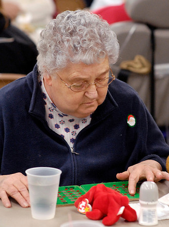 Barbara Updike, from Keystone Assisted Living, covers one of her numbers as she plays bingo at the monthly senior bingo game at Rangeline Community Center.