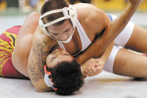Elwood's Will Maluvac and Alexandria's Marcus Carter wrestle for the 182 lb. championship during the Madison County Wrestling Tournament at Pendleton Heights on Saturday. Maluvac won by fall.