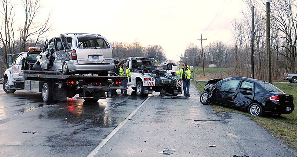 Employees from Northwest Towing recover a Chevrolet mini van and Ford Focus involved in an accident on Indiana 67 on Thursday afternoon.