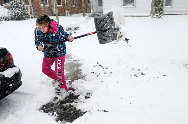 Kathryn Powless shovels snow from the front of her residence on Central Ave. on Wednesday.