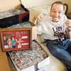 "Larry Vanness, also known as the Canman, sits with 55,332 pop can tabs in his Anderson apartment while holding up his 8 and 9 millionth pop tabs. Vanness will have donated over 9 million pop can tabs to the Ronald McDonald house after he makes a delivery today (Thursday). ""I'd like to thank all the people that has helped me,"" Vanness said, pointing out that he couldn't have done the work all by himself especially since he can't get around as well as he used to. ""They collect them, I just count them."" Those helpers include Anderson school children and recently the Best Western Plus that donated over 8,000 tabs during Vanness' stay at the hotel while his apartment was renovated."