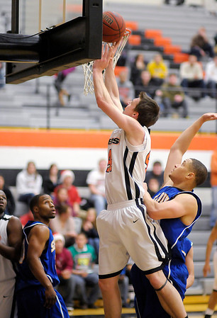 Anderson University's Nate Gross scores from the low post as the Ravens hosted Spalding University on Wednesday.