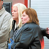 Pamela DeGraw watches with Dianna Hendricks as Anderson firefighters battle a blaze at 2209 E. 10th Street Monday morning.  DeGraw owns the building and Hendricks has her business, B & D Needful Things, in the structure.