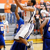 Anderson University's Phil Hogan drives to the basket as the Ravens hosted Spalding University on Wednesday.