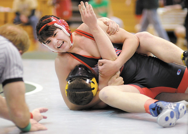 Frankton's Aaron Ray and Alexandria's Colt Welsh wrestle for the 195 pound championship during the Madison County Wrestling Tournament at Pendleton Heights on Saturday. Ray won by fall.