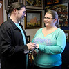 Christian Orth puts a ring on the finger of his bride Kellie Hott as they exchange vows in the office of Judge Thomas Newman Jr. on Wednesday.