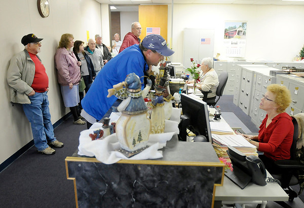 Bobby Faulds files his homestead deduction with Dawn Shank at the Auditors office on Wednesday.