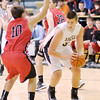 Madison-Grant's Tanner Wise moves into the low post against Blackford's Blake Thiery on Wednesday.