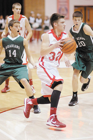 Frankton's Nick Wright drives to the basket as the Eagles hosted Pendleton Heights in the first round of the Madison County Basketball Tournament on Saturday.