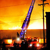 A ladder truck is used as firefighters from Elwood and surrounding communities battle a fire at the old State Plating building in Elwood.