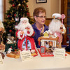 Greta Jones with some of  her homemade Santas that are on display at the History Center.