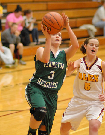 Pendleton Heights senior guard Meghan Dawson goes in for a second half lay up.