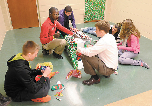Sophomores at Anderson High School prepare gifts for their Secret Santa program. From left are Ben Watson, sophomore class sponsor Grerayle Walton, Andrew Pancol, sophomore class president Hamilton Smith, Brittney DiEgidio and Marissa Childs.