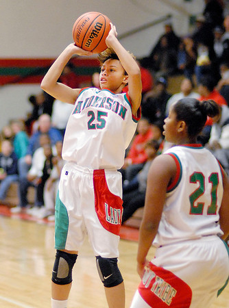 Darien Thompson takes a three point shot for the Lady Tribe.