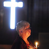 JoEllen McFall listens to Pastor John Hannum during a candlelight service at the New Hope Christian Church in Anderson.