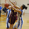 Alexandria freshman Paxton Quinn gets fouled while driving for the basket during the Lady Tigers game against Anderson Preparatory Academy Tuesday night.