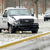 A Terminix truck sits in the median on University as icy roads made for difficult driving conditions on Friday.