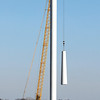 Workers from White Construction, Inc. lift the top section of this turbine tower in place off of Division Road and 600E in Tipton County Wednesday as they work to get 32 more turbines up before the end of the year.