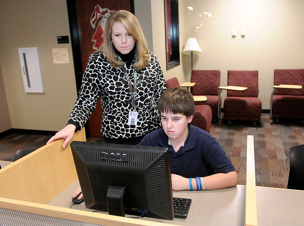 Jennifer Hudson Roberts works with Highland 7th grader Colton Brooks, 13, on acuity testing on Thursday.