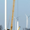 Workers from White Construction, Inc. prepare to left the top section of this turbine tower off of Division Road and 600E in Tipton County Wednesday as they work to get 32 more turbines up before the end of the year.
