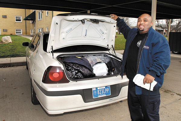 Antoine Robinson has is trunk full as he moves his family out of the Arbor Village Apartments Thursday.  Robinson, who has lived in the complex for 7 years, said he and his family will stay in a motel for several days till he can get things sorted out for his next move.