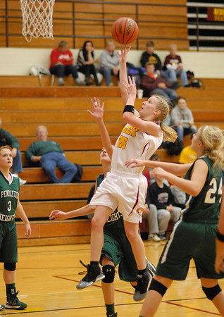 Alexandria junior Kelsey Crisp drives toward the basket during the Lady Tigers home game against Pendleton Heights.