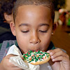 Josiah Henderson, 8, can't wait to bite into the cookie he decorated at the Soroptimist Cookie Walk Friday at the Union Building during Winterfest.
