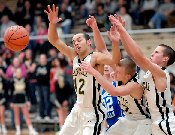 Daleville's James Tungate, Jarred Riddle, and Garrett Craig seem to be fighting each other while going after the loose basketball during their game with Southern Wells Friday evening.