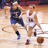 Frankton's Ashtyn Rastetter drives up the court against Southern Wells  Lela Knowles.