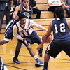 APA's Montel Wheeler drives between two Shortridge defenders as he cuts through the lane.