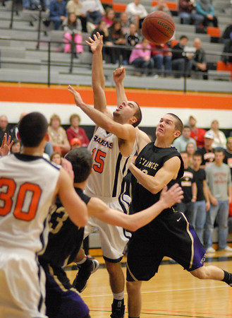 Anderson University Raven Isaac Loechle loses control of the ball while driving toward the basket.