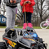 Cousins Nysia Agnew, 11, and Artiana Howard, 7, race their new radio-remote vehicles they received for Christmas out in the driveway Tuesday afternoon.  They were at their grandmothers Edgewood home for Christmas and took advantage of the weather to play outside with the toys before the snow hits Wednesday.