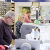 Working behind the counter at Gwinn's drug store from left are Paul Jefferis, Hollee Olinger and Jim Hoffman. Gwinn's closed for the last time on Wednesday.