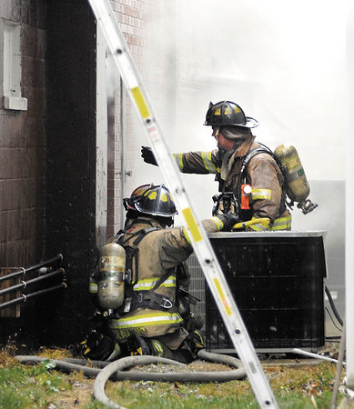 Anderson firefighters battled a smoky fire at 2209 E. 10th Street that housed B & D Needful Things Monday morning.
