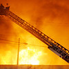 Elwood with aid from several other fire departments battles a fire at the old State Plating building in Elwood.