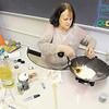 Sara Rich, an ACS preschool teacher, makes play dough as a Christmas gift for her students.