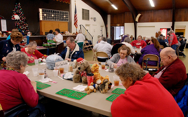 Residents from Alexandria Care Center check their bingo cards as numbers are called out during the monthly free senior bingo that the Rangeline Community Center offers to area facilities.