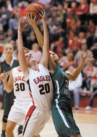 Frankton's Payton Dellinger and Kiawna Cottrell grab for a rebound during the Madison County Basketball Tournament on Saturday.