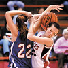 Southern Wells Ashton Prible and Frankton's  Payton Dellinger fight for the ball during their game Monday evening.