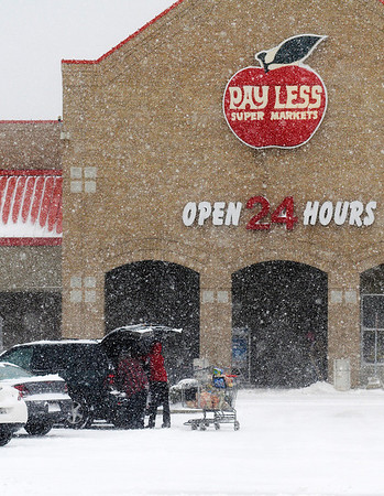 Payless was open for business and the parking lot was full of customers as residents stock up to ride out the winter storm on Wednesday.