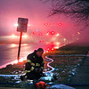 A firefighter changes air tanks as the Elwood and Pipe Creek Township Fire <br /> departments battle a blaze at a old factory building in the 900 block of North Ninth Street in Elwood Monday.