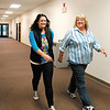 Claire Padgett and Betsy Sheets, claims managers for Unified Group Services, get their 30 minute walk in along the hallways of the southeast side business.<br />  Unified Group Services pays their employees to walk 3 days a week, 30 minutes at a time, to keep fit in the workplace.