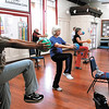 Members of the Silver Sneakers fitness class at YMCA go through their workout at the Anderson facility.