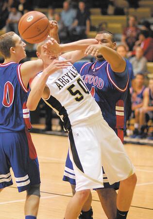 Madison Grant senior Jake Lemon gets the ball knocked away by Elwood Panther Anthony Bennett.