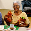 Alice Stewart, from Keystone Assisted Living shows off the stuffed animals she's won at the monthly senior bingo games at Rangeline Community Center.