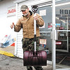 Larry Sparks leaves the Northgate True Value Hardware store in Anderson with two snow shovels in hand Monday morning.