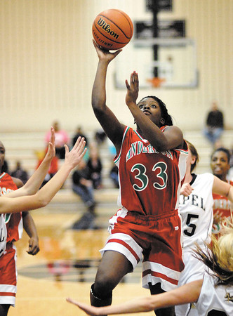 Anderson senior Taylor Potts drives through the foul lane for the Lady Tribe.